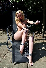 Nude girl Sunbathing shackled In Chains