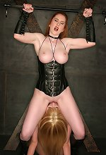Busty domina and submissive slave licking her mistress p..
